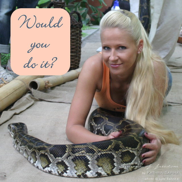 Travel blogger Kathrin Sapiha lies on a python - Would you do it?