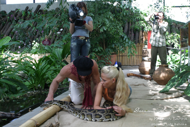 Travel blogger Kathrin on a python snake