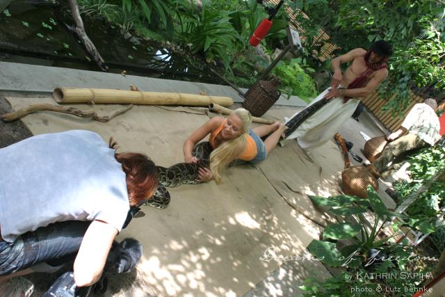 Female travel blogger on tv - Riding a python - Travel blog Dreams of Freedom by Kathrin Sapiha