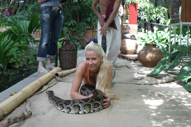 I made it! I survived riding a python!